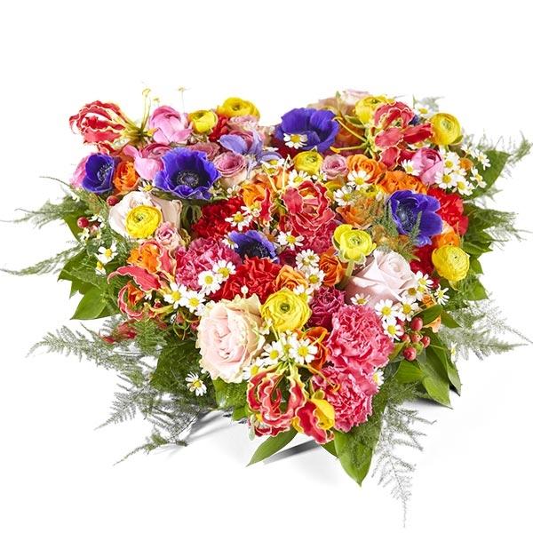 Rouwstuk hart met gemengde bloemen