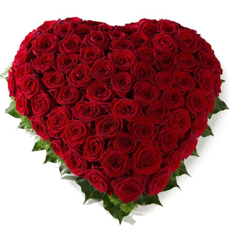 Rouwarrangement hart van rode Rozen