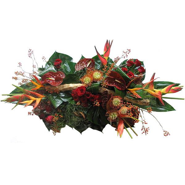 Rouwarrangement langwerpig rode tinten en luxe bloemen
