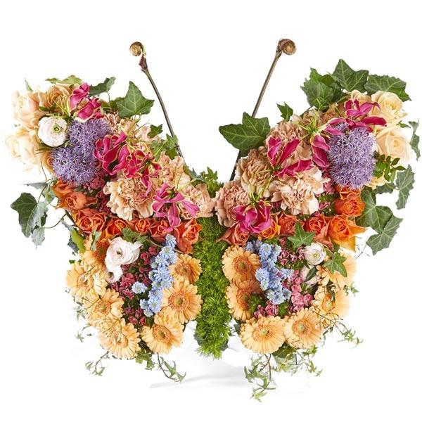 Rouwstuk Vlinder met gemengde bloemen